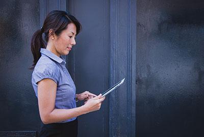 Woman is looking at ipad