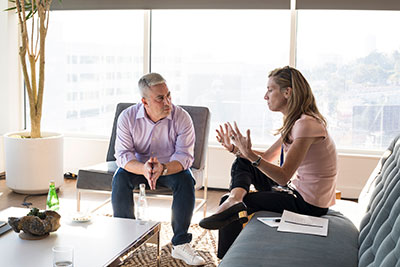 a man and a woman talking